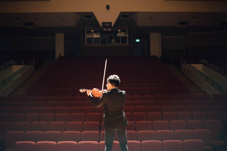 guy on violin alone