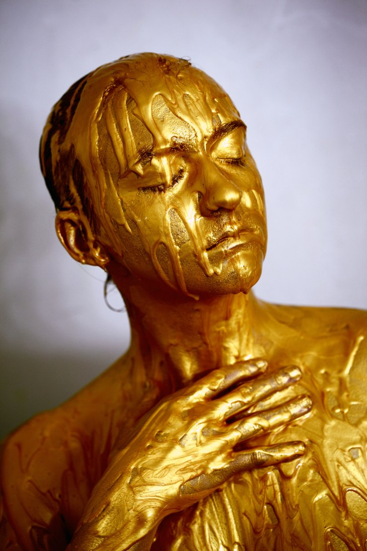gold paint on girl