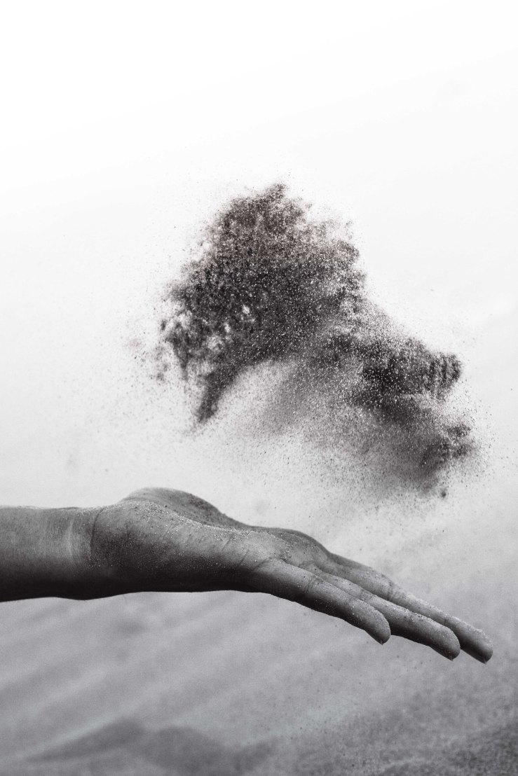 hand and sand
